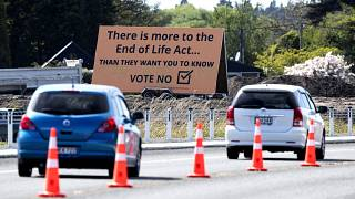 "In this Oct. 16, 2020, file photo, cars are driven past a billboard urging voters to vote ""No"" against euthanasia in Christchurch, New Zealand"