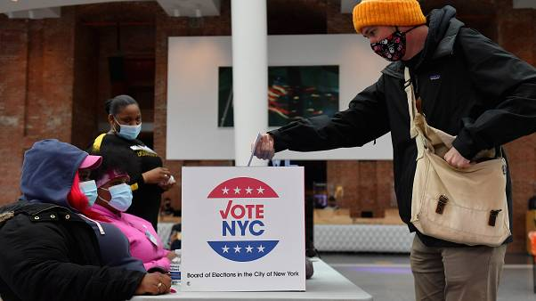 A voter drops off his early voting ballot for the 2020 Presidential election at the Brooklyn Museum in New York City on October 30, 2020.