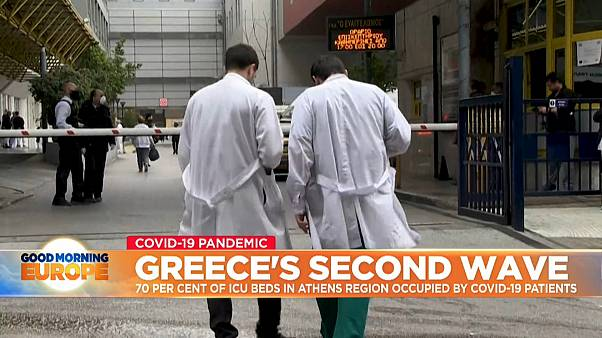 Doctors outside hospital in Athens