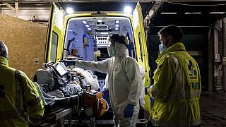Ambulance crew work as a patient arrives at the CHR CItadelle hospital in Liege, Belgium