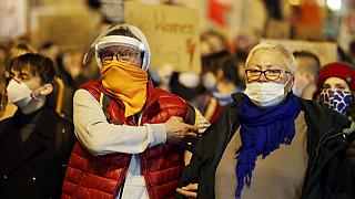 People in Warsaw taking part in a protest against the government on the eighth straight day of angry demonstrations that were triggered by a recent tightening of the abortion