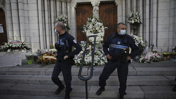 Municipal policemen stand guard outside Notre Dame church in Nice, France