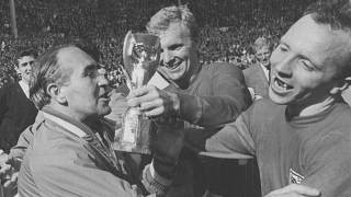 FILE - In this July 30, 1966 file photo, Nobby Stiles, right, looks at the Jules Rimet Cup, held by England captain Bobby Moore after they had won the trophy