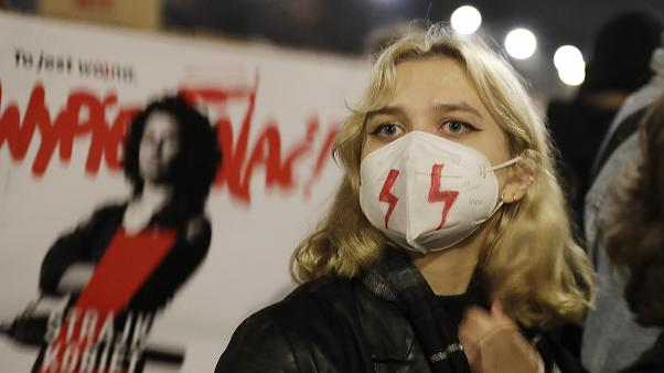 Young people take part in one of several protests against the conservative government triggered by a tightening of the abortion law, Warsaw, Poland, Friday, Oct. 30, 2020.