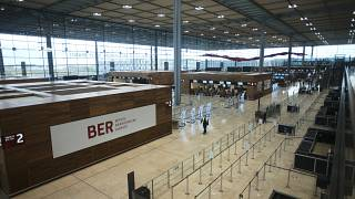 People walk through the Terminal 1 of the new Berlin-Brandenburg-Airport 'Willy Brandt' near Berlin in Schoenefeld, Germany, Tuesday, Oct. 27, 2020