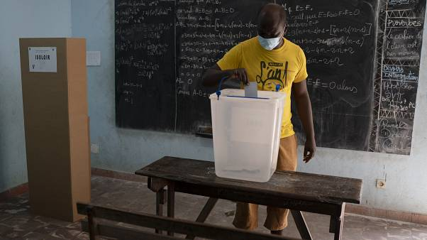 A man casts his vote during presidential election in Abidjan, Ivory Coast, Saturday, Oct. 31, 2020