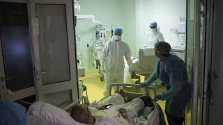 A medical crew receive a COVID-19 patient into the intensive care unit at the Joseph Imbert Hospital Center in Arles, southern France, Wednesday, Oct. 28, 2020