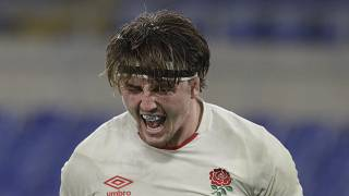 England's Tom Curry celebrates after scoring a try during the Six Nations rugby union international match between Italy and England at the Olympic Stadium in Rome, Italy,