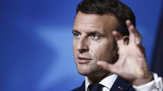French President Emmanuel Macron speaks during a media conference at the end of an EU summit in Brussels, Friday, Oct. 16, 2020.