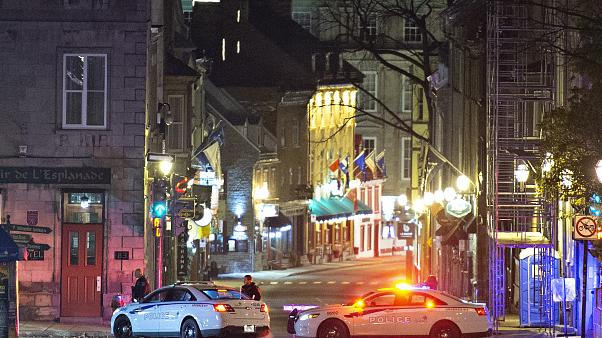 Police cars block the Saint-Louis Street near the Chateau Frontenac early Sunday, Nov. 1, 2020 in Quebec City