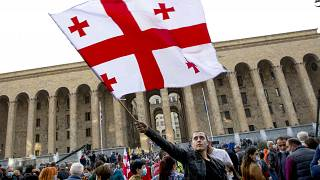 Protesters rally in front of the parliament's building in Tbilisi, Georgia, Sunday, Nov. 1, 2020
