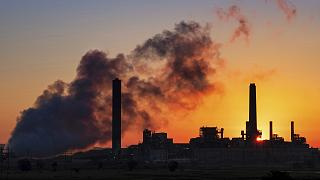 The Dave Johnson coal-fired power plant is silhouetted against the morning sun in Glenrock, Wyoming, USA.