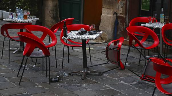 Chairs lie on the ground at the crime scene in a bar in Vienna, Austria, Tuesday, Nov. 3, 2020.