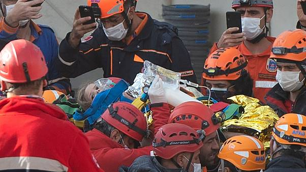 Rescue workers carry four-year-old girl Ayla Gezgin who was buried under rubble for 91 hours following the earthquake