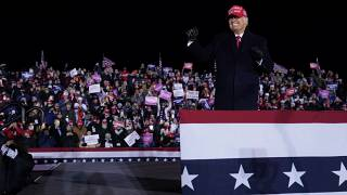 President Donald Trump on stage after a campaign rally at Gerald R. Ford International Airport, early Tuesday, Nov. 3, 2020, in Grand Rapids, Mich. (AP Photo/Evan Vucci)