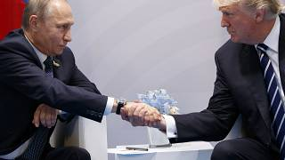In this July 7, 2017, file photo, US President Donald Trump shakes hands with Russian President Vladimir Putin at the G20 Summit in Hamburg