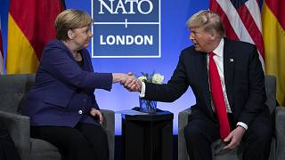 President Donald Trump shakes hands with German Chancellor Angela Merkel during the NATO summit at The Grove in Watford, England, in December 2019.