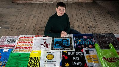 British artist Katrina Cobain poses for photographs with some of her collection of plastic bags.