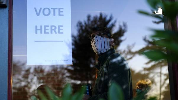 A voter lines up in a polling place to cast a ballot in Springfield, Pennsylvania.