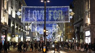 Shoppers make their way along Oxford Street in central London