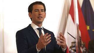 Austrian Chancellor Sebastian Kurz speaks during a press conference behind plexiglass shields at the federal chancellery in Vienna, Austria, Saturday, Oct. 31, 2020.