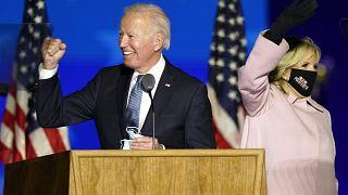 Joe Biden arrives with his wife Jill Biden to speak to supporters Wednesday, Nov. 4, 2020, in Wilmington, Del