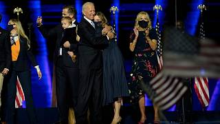 President-elect Joe Biden, center, with his wife Jill Biden and members of this family on stage, Saturday, Nov. 7, 2020, in Wilmington, Del.