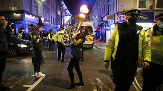 Revellers enjoy a last night out in London before a second coronavirus lockdown comes into force