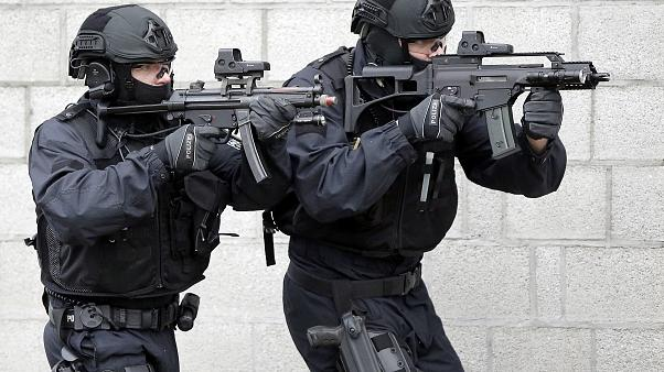 Police officers hold weapons during a training operation of the new BFE+ (Evidence and Arrestment) unit of the German federal police in Ahrensfelde near Berlin, Germany, Thurs
