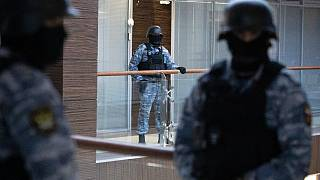 Security officers standing guard at the Alexei Navalny's Foundation for Fighting Corruption office in Moscow, Russia, Thursday, Nov. 5, 2020.