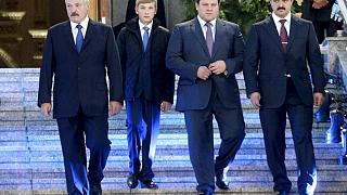 In this photo taken Friday, Oct. 2, 2015, Belarusian President Alexander Lukashenko, left, with his sons, from right, Viktor, Dmitry and Nikolai, walk after a church service.