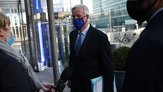 European Commission's Head of Task Force for Relations with the United Kingdom Michel Barnier talks to journalists as he leaves the European Commission headquarters in Brussel