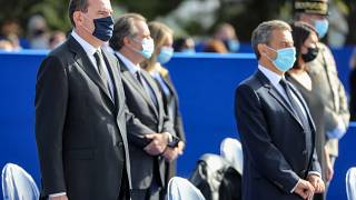 French Prime Minister Jean Castex (L) and former French president Nicolas Sarkozy (R) attend a ceremony in Nice, on November 7, 2020