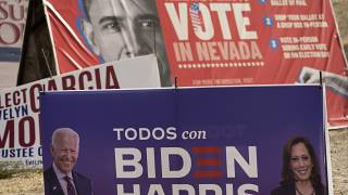 A campaign sign supporting Democratic presidential candidate Joe Biden and running mate Kamala Harris stands in front of a vote sign showing former President Obama.