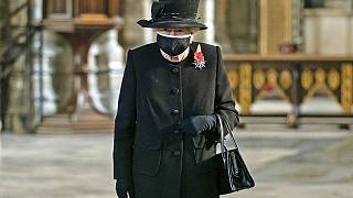 Britain's Queen Elizabeth II attends a ceremony to mark the centenary of the burial of the Unknown Warrior, in Westminster Abbey, London, Wednesday, Nov. 4, 2020.