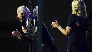 President-elect Joe Biden reacts on stage with Jill Biden after speaking, Nov. 7, 2020, in Wilmington, Del.