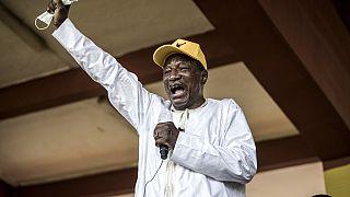 Alpha Condé parade en vainqueur à Conakry