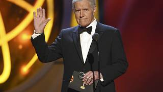 FILE - This May 5, 2019, file photo shows Alex Trebek gestures while presenting an award at the 46th annual Daytime Emmy Awards in Pasadena, Calif.
