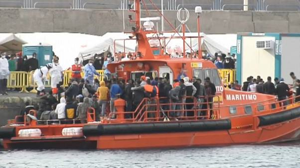 Migrants on an emergency services boat