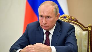 Russian President Vladimir Putin attends a meeting via video conference in Moscow, Russia, Thursday, Nov. 5, 2020.