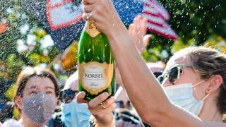 Happy voters pop champagne in Washington DC after Joe Biden wins presidential election.