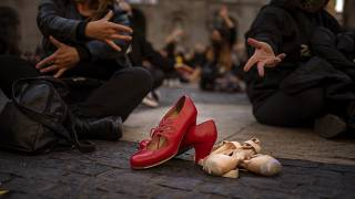 Dancing shoes are placed on the ground with their dancer owners during a protest organised by dance associations against virus restrictions, in Barcelona