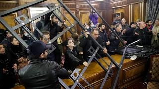 People crash a construction as they broke into the government building protesting against an agreement to halt fighting over the Nagorno-Karabakh region, in Yerevan, Armenia