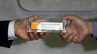 Sao Paulo Governor Joao Doria, left, and Butantan Institute Director Dimas Covas show a box of an experimental COVID-19 vaccine. Sao Paulo, Brazil, Monday, Nov. 9, 2020.