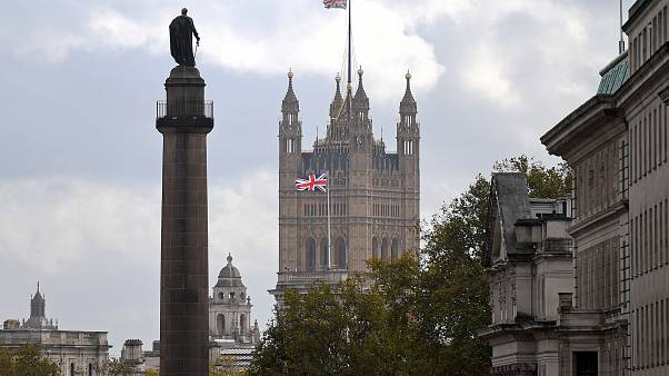 A Union flag flies atop the the Victoria Tower at Britain's Houses of Parliament, incorporating the House of Lords and the House of Commons, in London on October 20, 2020.