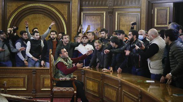 Demonstrators argue after break into Armenian government buildings and parliament. Yerevan. Nov 10, 2020