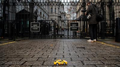 Greenpeace activists hold remote-controlled car race outside London's 10 Downing Street.