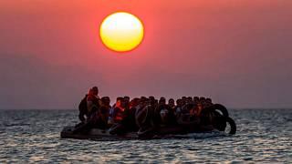 In this file photo taken on Aug. 13, 2015, migrants on a dinghy approach the southeastern island of Kos, Greece