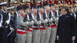 French President Emmanuel Macron reviews the troops as he inaugurates a memorial for soldiers fallen in foreign conflicts, Monday Nov. 11, 2019 in Paris.