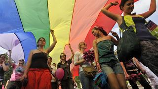 LGBT right activists march with a rainbow flag during the Gay Pride parade in Budapest.